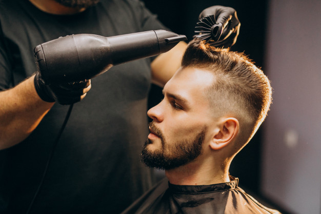 handsome-man-barber-shop-styling-hair_1303-20978